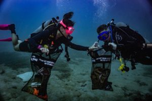 Scuba Sarah Damours and Dan Sherwood leading a dive against debris with Big Bubble Dive